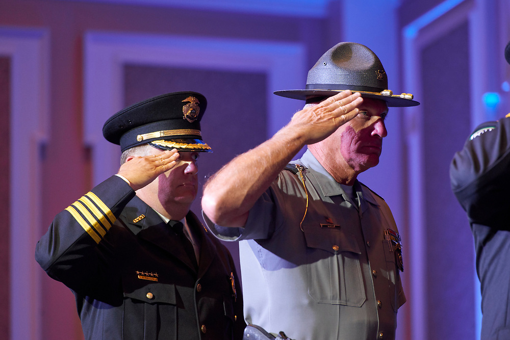 Chief Powers and State Highway Patrol Superintendant Pride salute the flag during the national anthem.