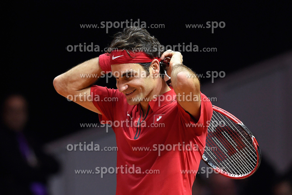21.11.2014, Stade Pierre Mauroy, Lille, FRA, Davis Cup Finale, Frankreich vs Schweiz, im Bild Roger Federer (SUI) // during the Davis Cup Final between France and Switzerland at the Stade Pierre Mauroy in Lille, France on 2014/11/21. EXPA Pictures © 2014, PhotoCredit: EXPA/ Freshfocus/ Valeriano Di Domenico<br /> <br /> *****ATTENTION - for AUT, SLO, CRO, SRB, BIH, MAZ only*****