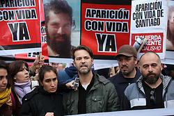 August 7, 2017 - Buenos Aires, Buenos Aires, Argentina - Outside the Parliament a protest was carried out to ask for the appearance of Santiago Maldonado, the artisan of Chubut whose whereabouts has not been known since August 1st. At the end of the peaceful demonstration, a group of people linked to an anarchist group - several with hoods covering their faces - began to attack the police and the journalists who covered the march. The group violently beat several journalists and set fire to a police motorcycle. (Credit Image: © Claudio Santisteban via ZUMA Wire)