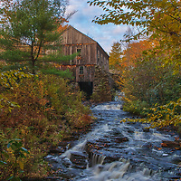 Moore State Park in Paxton is a peaceful retreat in the heart of central Massachusetts. This photo includes the Sawmill and was taken on a beautiful autumn late afternoon when New England fall color was at peak and the sky featured a great mixture of blue sky and clouds.<br />