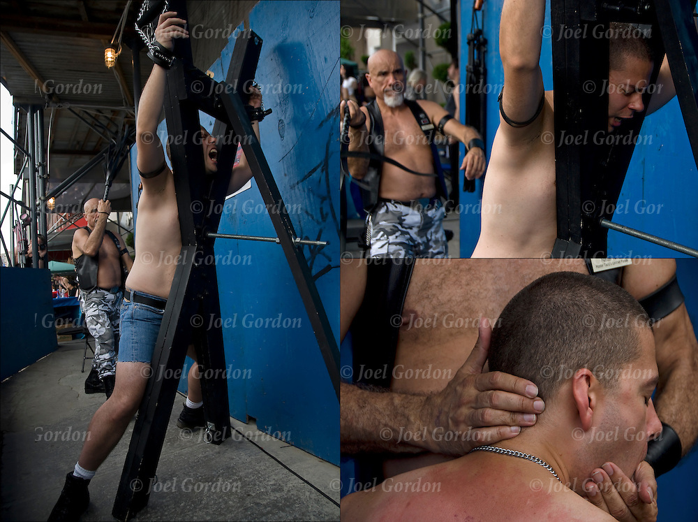 Bondage slave being whipped and flogged by master at the S&amp;M Bondage  adult-themed Street fair Folsom Street East in New York City. <br />