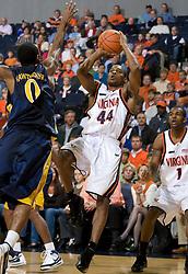 Virginia guard Sean Singletary (44) shoots over Drexel guard Tramayne Hawthorne (0) while falling backwards.  The #23 Virginia Cavaliers men's basketball team faced the Drexel Dragons  at the John Paul Jones Arena in Charlottesville, VA on November 20, 2007.