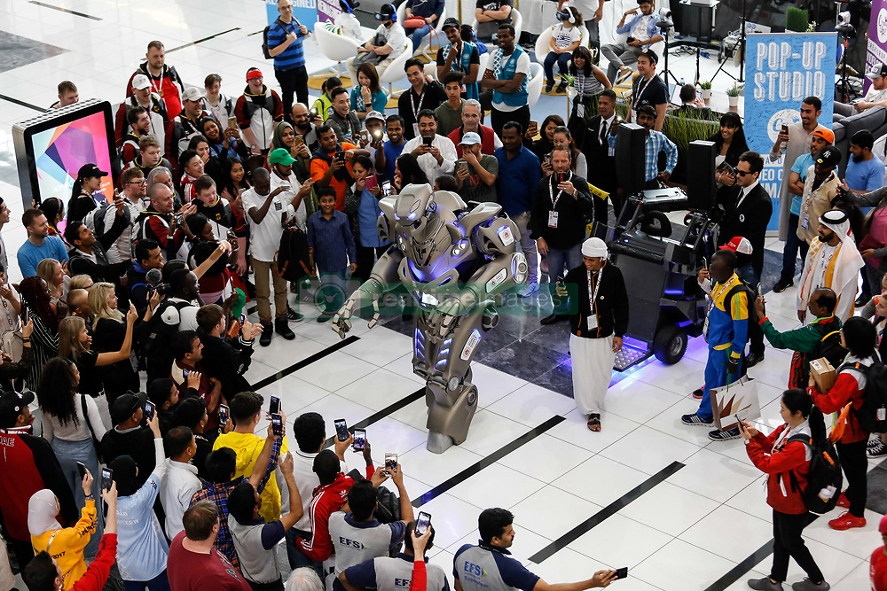 March 15, 2019 - Abu Dhabi, United Arab Emirates - Crowd watches Special Olympics World Games robot mascot in Abu Dhabi National Exhibition Centre, United Arab Emirates on March 15, 2019. Special Olympics is a worldwide organization which organize sports competitions for people with learning difficulties. Summer World Games take place every 4 years. 7500 athletes from nearly 200 countries compete in 24 Olympic Sport disciplines in Abu Dhabi Games in 2019. (Credit Image: © Dominika Zarzycka/NurPhoto via ZUMA Press)