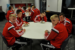 NEWPORT, WALES - Tuesday, September 23, 2014: Wales players have snacks before the Under-16's International Friendly match against France at Dragon Park. (Pic by Cledwyn Ashford/Propaganda)