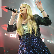 """WASHINGTON, DC - December 15th, 2014 - Meghan Trainor performs onstage during HOT 99.5's Jingle Ball 2014 at the Verizon Center in Washington, D.C. Her hit """"All About That Bass"""" topped the Billboard Hot 100 singles chart for eight consecutive weeks. (Photo By Kyle Gustafson / For The Washington Post)"""