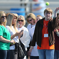 Kaylee Maddox tries an underhanded toss during the tennis ball throw event Wednesday.