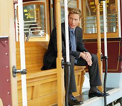 Buinessman sitting on a trolley car