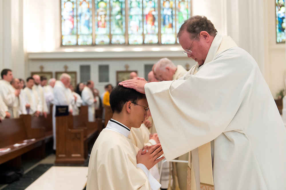 DENVER, CO - MAY 14: Priests lay hands on soon-to-be-ordained deacons during a priest ordination at the Cathedral Basilica of the Immaculate Conception on May 14, 2016, in Denver, Colorado. (Photo by Daniel Petty/Denver Catholic)
