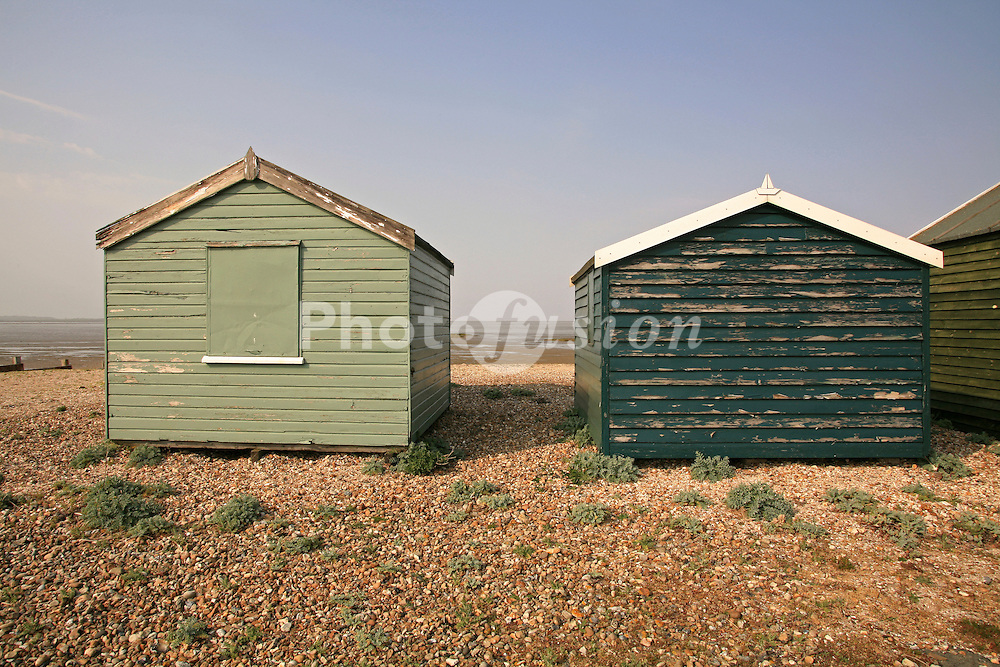 Weatherbeaten beach huts at Seasalter near Whitstable looking towards the Isle of Sheppey; Kent 2007