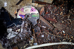 27 August 2014. Lower 9th Ward, New Orleans, Louisiana.<br /> Hurricane Katrina 9 years later. A CD slowly deteriorates inside one of he many derelict, falling down buildings dotting the landscape as the area struggles to recover from Hurricane Katrina.<br /> Photo; Charlie Varley/varleypix.com
