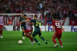 September 20, 2018 - Piraeus, Attiki, Greece - Kostas Tsimikas (no 21) of Olympiacos tries to avoid Giovani Lo Celso (no 21) of Real Betis. (Credit Image: © Dimitrios Karvountzis/Pacific Press via ZUMA Wire)