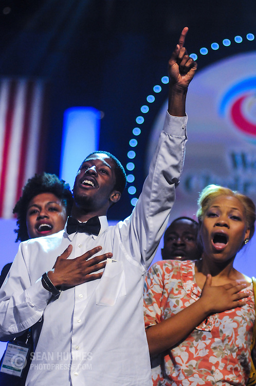 Members of the Jeremy Winston Chorale, USA, celebrate their victory in the Gospel category during the third of four Award Ceremonies at the World Choir Games, July 13, 2012. (Photo: Sean Hughes)