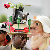 Eric Williams, from Chicago, bought a vintage camera off eBay to adorn his hat which is a tribute to the photographers over the years at the 138th running of the Kentucky Derby at Churchill Downs in Louisville, Ky. Saturday May 5, 2012.  Photo by David Stephenson