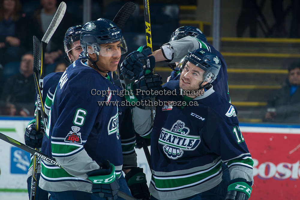 KELOWNA, CANADA - JANUARY 5: Blake Bargar #12 and Aaron Hyman #6 of the Seattle Thunderbirds celebrate a first period goal against the Kelowna Rockets on January 5, 2017 at Prospera Place in Kelowna, British Columbia, Canada.  (Photo by Marissa Baecker/Shoot the Breeze)  *** Local Caption ***