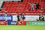 Forest Green Rovers forward Shawn McCoulsky (21) celebrates after scoring the winning penalty shoot-out goal during the EFL Cup match between Charlton Athletic and Forest Green Rovers at The Valley, London, England on 13 August 2019.