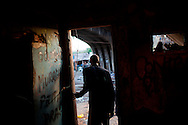 In this Aug. 12, 2012 photo, a crack user leaves a crack house near the Manguinhos slum in Rio de Janeiro, Brazil. <br /> <br /> <br />  The South American country began experiencing a public health emergency in recent years as demand for crack boomed and open-air &quot;cracolandias,&quot; or crack lands, popped up in the sprawling urban centers of Rio and Sao Paulo, with hundreds of users gathering to smoke the drug. The federal government announced in early 2012 that more than $2 billion would be spent to fight the epidemic, with the money spent to train local health care workers, purchase thousands of hospital and shelter beds for emergency treatment, and create transitional centers for recovering users.