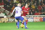 Barnsley midfielder Brad Potts (20) and Portsmouth defender Jack Whatmough (16) battle for the ball during the EFL Sky Bet League 1 match between Barnsley and Portsmouth at Oakwell, Barnsley, England on 15 December 2018.
