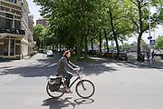 Een vrouw fietst door Groningen.<br /> <br /> A woman is cycling in Groningen.
