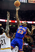 Feb. 25, 2011; Cleveland, OH, USA; New York Knicks guard Toney Douglas (23) shoots over Cleveland Cavaliers power forward J.J. Hickson (21) during the first quarter at Quicken Loans Arena. Mandatory Credit: Jason Miller-US PRESSWIRE