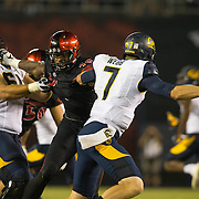 10 September 2016: The San Diego State Aztecs football team hosts Cal in their second game of the season. San Diego State linebacker Randy Ricks (40) flushes Cal quarterback Davis Webb (7) out of the pocket in the fourth quarter. The Aztecs beat Cal 45-40 to keep their win streak at 12 games going back to last season and improve their record to 2-0.