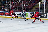 KELOWNA, CANADA - MARCH 3:  Ted Brennan #10 of the Kelowna Rockets tries to block a shot by Clay Hanus #58 of the Portland Winterhawks on March 3, 2019 at Prospera Place in Kelowna, British Columbia, Canada.  (Photo by Marissa Baecker/Shoot the Breeze)