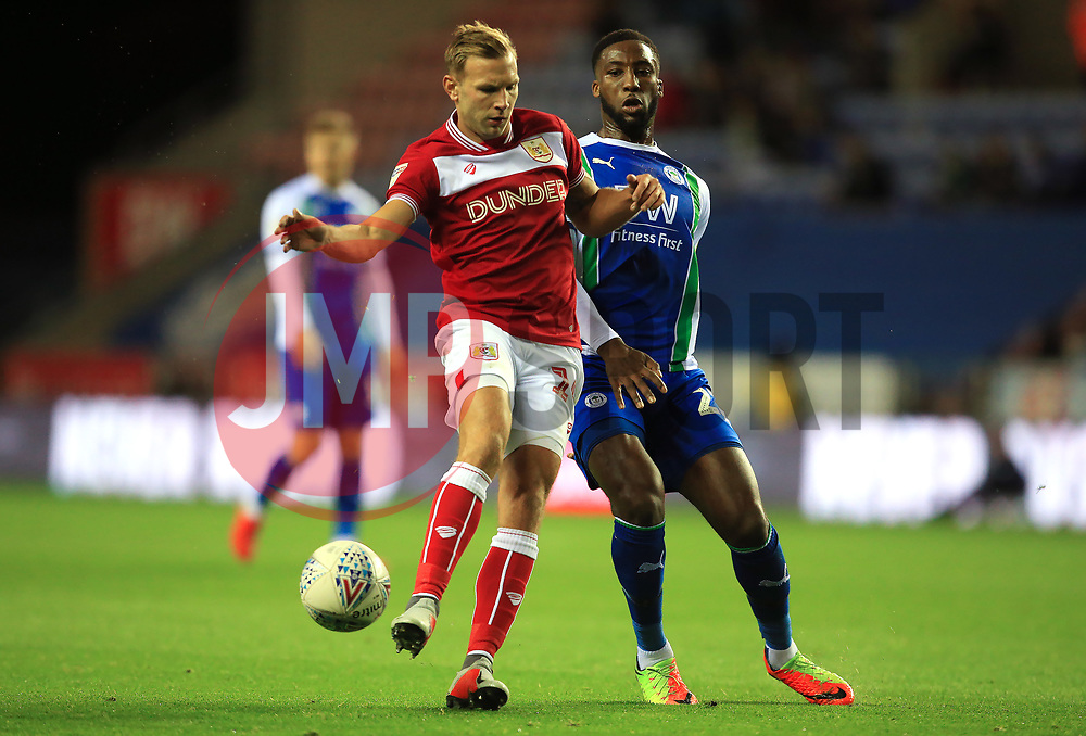Bristol City's Andreas Wiemann challenges Wigan Athletic's Chey Dunkley - Mandatory by-line: Matt McNulty/JMP - 21/09/2018 - FOOTBALL - DW Stadium - Wigan, England - Wigan Athletic v Bristol City - Sky Bet Championship