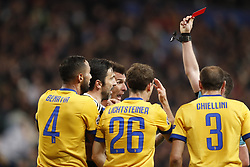 (l-r) Medhi Benatia of Juventus FC, goalkeeper Gianluigi Buffon of Juventus FC, Mario Mandzukic of Juventus FC, goalkeeper Wojciech Szczesny of Juventus FC, referee Michael Oliver, Giorgio Chiellini of Juventus FC during the UEFA Champions League quarter final match between Real Madrid and Juventus FC at the Santiago Bernabeu stadium on April 11, 2018 in Madrid, Spain