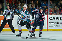 KELOWNA, CANADA - JANUARY 3: Nolan Foote #29 of the Kelowna Rockets stick checks Parker AuCoin #32 of the Tri-City Americans on January 3, 2017 at Prospera Place in Kelowna, British Columbia, Canada.  (Photo by Marissa Baecker/Shoot the Breeze)  *** Local Caption ***