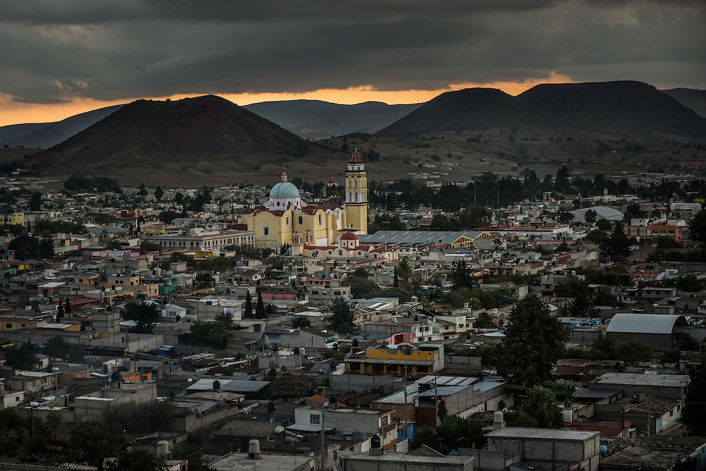 CIUDAD SERDÁN, MEXICO - MARCH 28, 2015: San Andrés Apóstol Catholic church dominates the view of Ciudad Serdán, where the LMT basecamp is located. On clear days, the LMT is visible from the town. PHOTO: Meridith Kohut for The New York Times