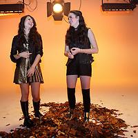 Nederland, Amsterdam, 9 november 2014.<br /> Sarah (16 jaar) en Julia (13 jaar) tijdens de videoclip opnamen voor hun nieuwe single 'Gold'. Zij hebben vorig jaar meegedaan met het Junior Songfestival en eindigden als 3de in de finale met hun nummer 'Live life' http://youtu.be/cI2Ea2PcoS8 geproduceerd door Jochem Fluitsma en Eric van Tijn. Afgelopen maart hebben zij de single 'Celebrate we're young' http://youtu.be/XGP-ex6V4fs uitgebracht en behaalden daarmee (2x) de 1ste plaats in de Kidstop 20!<br /> <br /> Deze nieuwe single wordt opgemaakt door allemaal tieners:<br /> - Nils Verkooijen (17 jaar) en o.a. bekend als acteur in films als 'Achtste groepers huilen niet', 'Spijt' en 'Dansen op de vulkaan' is opnameleider;<br /> - Mischa Dols (18 jaar) heeft video's gemaakt voor 'Just Iris' (Cups), 'Yes-R' (Onbereikbaar) en ook de videoclip 'Celebrate we're young' is de regisseur;<br /> - Jim Stuurman (net 18 jaar) heeft gefilmd bij o.a. bovenstaande videoclips en 'Dansen op de vulkaan' is cameraman;<br /> De choreografie is gemaakt door de dansers in de clip: Leslie de Koning (16 jaar) (winnaar Avro Junior Dance 2012 en So you think you can dance Next Generation in 2013) en Lars Bohte (16 jaar).<br /> <br /> Foto:Jean-Pierre Jans
