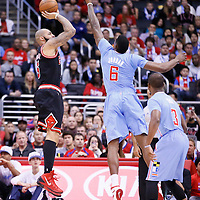 24 November 2013: Chicago Bulls power forward Carlos Boozer (5) takes a jumpshot over Los Angeles Clippers center DeAndre Jordan (6) during the Los Angeles Clippers 121-82 victory over the Chicago Bulls at the Staples Center, Los Angeles, California, USA.