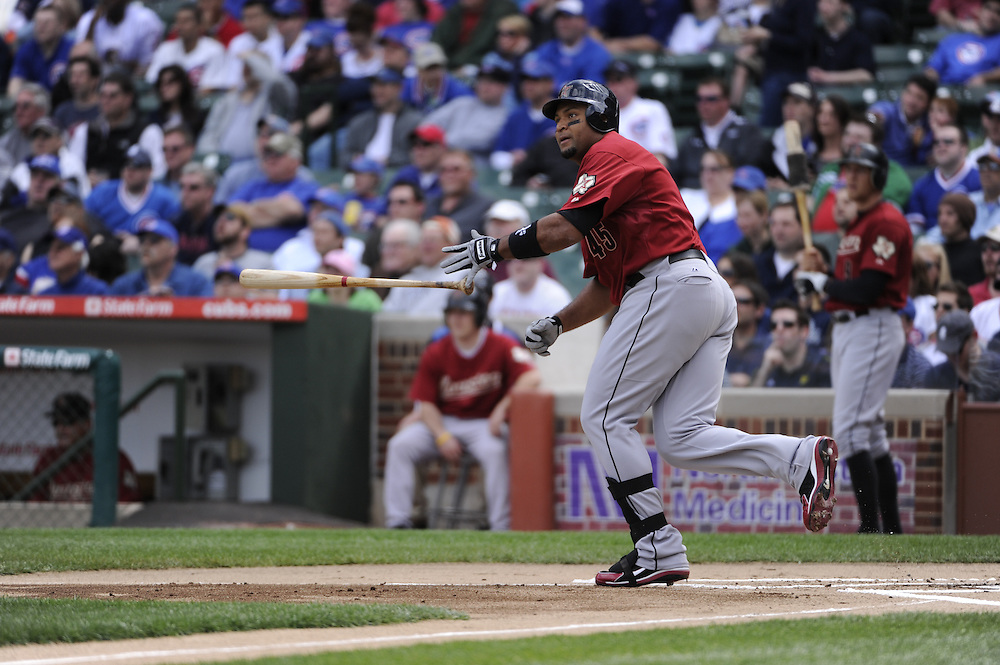 CHICAGO - APRIL 16:  Carlos Lee #45 of the Houston Astros bats against the Chicago Cubs on April 16, 2010 at Wrigley Field in Chicago, Illinois.  The Cubs defeated the Astros 7-2.  (Photo by Ron Vesely)