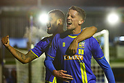 James Ball scores a goal to make it 3-0 and celebrates with Paul McCallum during the The FA Cup match between Solihull Moors and Rotherham United at the Automated Technology Group Stadium, Solihull, United Kingdom on 2 December 2019.