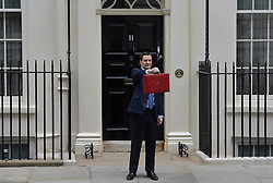 The Chancellor George Osborne poses on the steps of No11 Downing street with his red budget box for the 2014 Budget, London, United Kingdom. Wednesday, 19th March 2014. Picture by Ben Stevens / i-Images