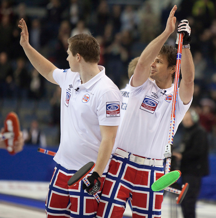 Norway's skip Thomas Ulsrud, right, celebrates with teammates following their 7-2 vicory over Sweden in the 3-4 page playoff draw at the Ford World Men's Curling Championships in Regina, Saskatchewan, April 9, 2011.<br /> AFP PHOTO/Geoff Robins