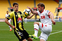 Adelaide United's Nikola Mileusnic, right and Phoenix's Matthew Ridenton contest the ball in  the A-League football match at Westpac Stadium, Wellington, New Zealand, Sunday, October 08, 2017. Credit:SNPA / Dean Pemberton **NO ARCHIVING**
