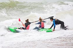 © Licensed to London News Pictures. 22/07/2017. Brighton, UK. Members of the public trying to go kayaking as powerful waves block their path out to sea. Cold temperatures are hitting the seaside resort throughout the Saturday. Photo credit: Hugo Michiels/LNP
