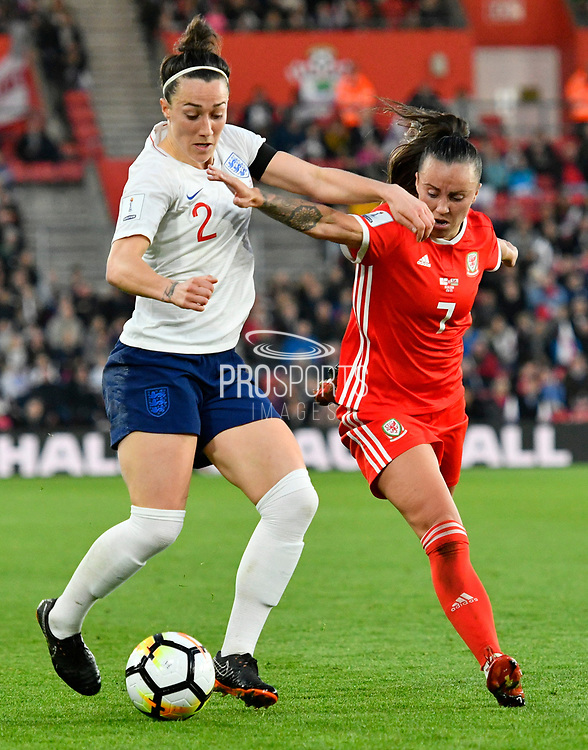 Lucia Bronze (2) of England battles for possession with Natasha Harding (7) of Wales during the FIFA Women's World Cup UEFA Qualifier match between England Ladies and Wales Women at the St Mary's Stadium, Southampton, England on 6 April 2018. Picture by Graham Hunt.
