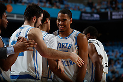 CHAPEL HILL, NC - FEBRUARY 05: Garrison Brooks #15 of the North Carolina Tar Heels smiles with teammates during a game against the North Carolina State Wolfpack on February 05, 2019 at the Dean Smith Center in Chapel Hill, North Carolina. North Carolina won 113-96. North Carolina wore retro uniforms to honor the 50th anniversary of the 1967-69 team. (Photo by Peyton Williams/UNC/Getty Images) *** Local Caption *** Garrison Brooks