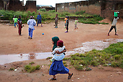 Muslim children are playing football next to a series of destroyed homes in Dutse Uku, pop. 40.000, a Muslim-dominated neighbourhood in Jos, Plateau State, Nigeria. Residents of Dutse Uku clashed and were attacked by a neighbouring Christian community after local government elections in 2008. 380 houses were destroyed, and around 20 people were killed. All Christians have since then left their homes within the community, in order to resettle in Christian-dominated areas of the city.