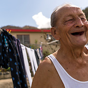 SEPTEMBER 29 - CAYEY, PUERTO RICO - <br /> Modesto Ramos, 84, laughs while talking about the plants and vegetation that were  damaged  by the winds packed by Hurricane Maria .<br /> (Photo by Angel Valentin for NPR)