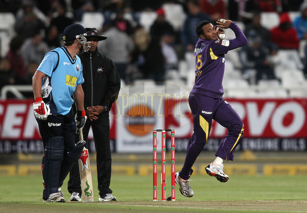 Shakib Al Hassan of the Kolkata Knight Riders sends down a delivery during match 5 of the Karbonn Smart CLT20 South Africa between The Kolkata Knight Riders and The Auckland Aces held at Newlands Stadium in Cape Town, South Africa on the 15th October 2012..Photo by Shaun Roy/SPORTZPICS/CLT20