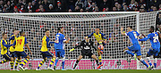Arsenal's Kieran Gibbs clears during the The FA Cup match between Brighton and Hove Albion and Arsenal at the American Express Community Stadium, Brighton and Hove, England on 25 January 2015. Photo by Phil Duncan.