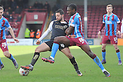 Fabien Robert (4) of Swindon Town and Hakeeb Adelakun of Scunthorpe United during the Sky Bet League 1 match between Scunthorpe United and Swindon Town at Glanford Park, Scunthorpe, England on 28 March 2016. Photo by Ian Lyall.