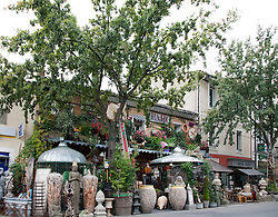 The offerings of the Cote Parc shop spill out onto the sidewalk, one of more than 300 antique and decorator shops for which the town of L'Isle-sur-la-Sorgue is famous.