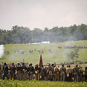 Confederate troops lined up, preparing to charge, during the reenactment of Pickett's Charge, at the Sesquicentennial Anniversary of the Battle of Gettysburg, Pennsylvania on Sunday, June 30, 2013.  A pivotal moment in the Civil War, over 50,000 soldiers died in the battle which spanned 3 days from July 1-3, 1863.  Later that year, President Abraham Lincoln returned to Gettysburg to deliver his now famous Gettysburg Address to dedicate the cemetery there for the Union soldiers who died in battle.  John Boal photography