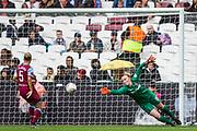 Courtney Brosnan (GK) (West Ham) saves a ball from Rianna Dean (Tottenham Hotspur) during the FA Women's Super League match between West Ham United Women and Tottenham Hotspur Women at the London Stadium, London, England on 29 September 2019.