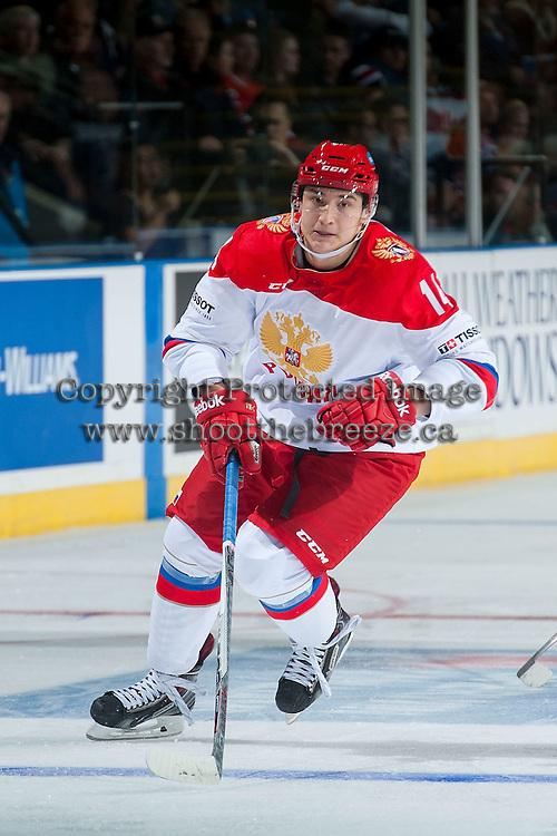 KELOWNA, CANADA - NOVEMBER 9: Marat Khayrullin #14 of Team Russia skates against the Team WHL on November 9, 2015 during game 1 of the Canada Russia Super Series at Prospera Place in Kelowna, British Columbia, Canada.  (Photo by Marissa Baecker/Western Hockey League)  *** Local Caption *** Marat Khayrullin;