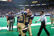 St. Louis Rams Linebacker Mark Fields (55) and Defensive back Aeneas Williams (35) celebrate after a 15 to 14 win over the New York Giants on 10/14/2001..©Wesley Hitt/NFL Photos