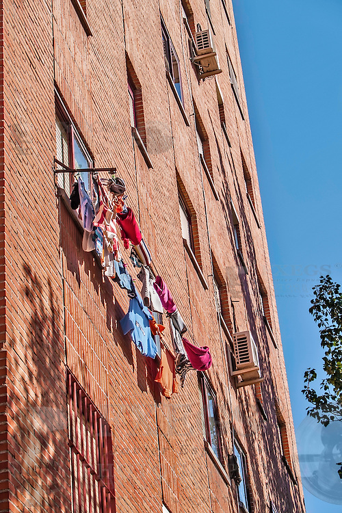 Madrid, August 2012. Laundry drying on a window in a residential building